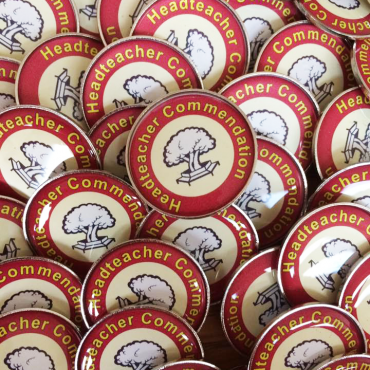 personalised round resin badges made in the UK by BadgeBoy - The Personalised Badge Experts